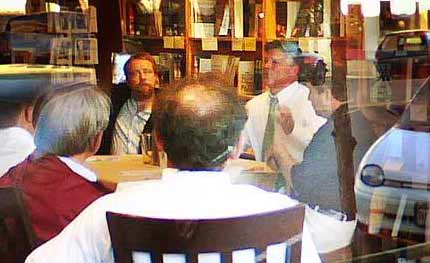 Mark Lewis took this photo of Gazette editor and hillbilly blowhard Sean Paige holding court recently in Poor Richards restaurant to discuss his leaving the city daily