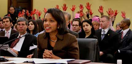 Condoleezza Rice testifies while Code Pink activists remind everyone of her bloody hands.