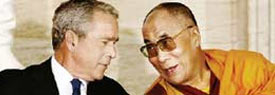 George Bush confers with the Dalai Lama