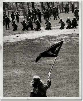 Alan Canfora waves the anarchist flag before he was shot in the wrist