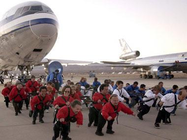 Midgets pulling a plane