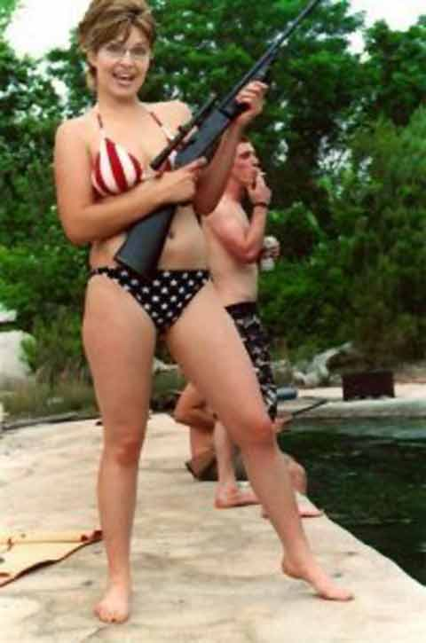 Sarah Palin poses with gun