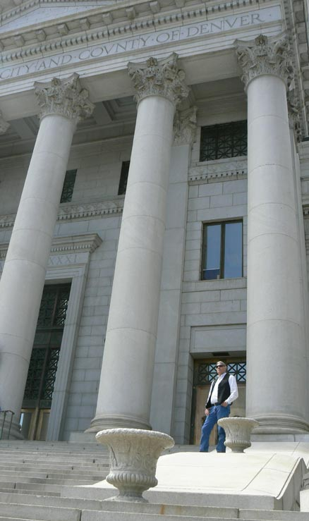 Professor Ward Churchill stands before Denver court house